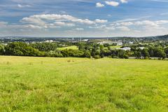 View from Berensberg over a meadow and the A4 motorway down to the northern p - stock photo