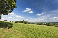 View from Berensberg over a meadow  down to the northern parts of Aachen. - stock photo