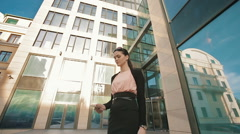 Business woman using cell phone Stock Footage