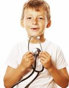 little cute boy with stethoscope playing like adult profession doctor close up - stock photo