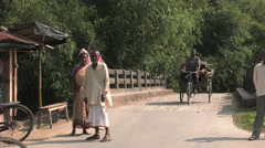 Tricycle bike on rural Indian street Stock Footage