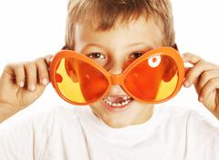 little cute boy in orange sunglasses pointing isolated close up part of face - stock photo
