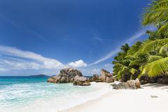 Perfect white beach Anse Patates in La Digue, Seychelles with clear water, gr Stock Photos
