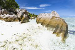 Beautiful white beach Anse Pierrot near Source D'Argent in La Digue, Seychell - stock photo