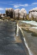 Rock formations at the remote beach Anse Aux Cedres, La Digue, Seychelles Stock Photos