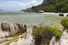 Beautiful lagoon Anse Pierrot near Source D'Argent in La Digue, Seychelles wi Stock Photos