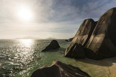 Sunset at Anse Source D'Argent in La Digue, Seychelles with granite rocks in  - stock photo