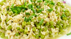 Rice with peas and chives on plate, rotating counter clockwise Stock Footage
