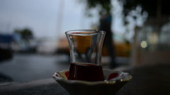 Arabian tea glass with busy city traffic in Istanbul, Turkey. Stock Footage