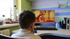 Small boy is watching cartoon. - stock footage