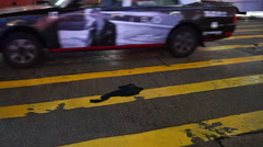 Hong Kong night street blurred video of city signs and transportations Stock Footage