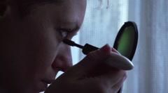 Make-up, doing eyelashes with mascara - stock footage