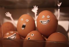 Rock and roll eggs partying in refrigerator Stock Photos
