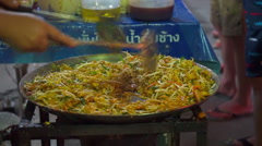 Woman's hands cooking Thai street food pad thai-1 Stock Footage