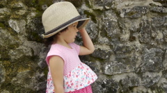 Portrait of a little girl in a hat in profile Stock Footage