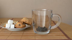 Tea is brewed in a glass mug Stock Footage
