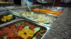 people group catering buffet food in restaurant with meat  fruits and vegetables - stock footage