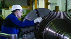 Lathe operator in a factory for the production repair rotor for compressor Stock Footage