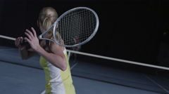 Point of view female tennis swing, male opponent in soft focus across court Stock Footage