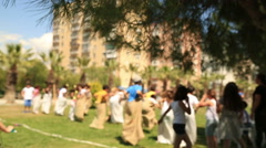 Group of kids competing at a sack race in summer 2 Stock Footage