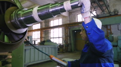 worker lathe operator in a factory transportation rotor parts - stock footage