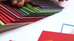 spreading color paper - stock footage