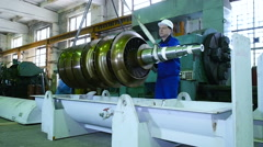 Worker lathe operator in a factory transportation rotor parts Stock Footage