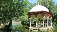 Panning shot of a pond in Parque de Maria Luisa in Seville Stock Footage