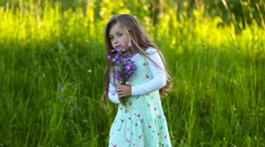 girl with a bouquet of flowers - stock footage