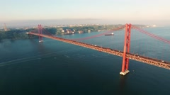 Bridge Ponte 25 de Abril over the river in Lisbon at morning aerial view Stock Footage