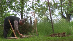 Man working in the backyard Stock Footage