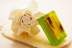 Closeup body sponge soap and scrub glove Stock Photos
