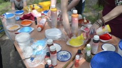 street artists and a table with different paints and brushes - stock footage
