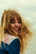 Girl enjoying summer breeze by seaside Stock Photos