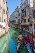 Two anchored gondolas in Venice. Venice canal with anchored gondolas Stock Photos