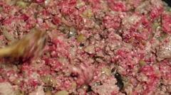 Preparing minced meat gravy sauce on a Teflon pan - stock footage