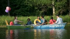 Happy people having fun in boats. Stock Footage