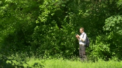 Man With Virtual Tablet in Green Park Holding a Tablet Spend Time at the Nature Stock Footage