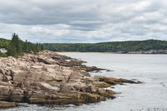 Acadia coastline under heavy clouds Stock Photos