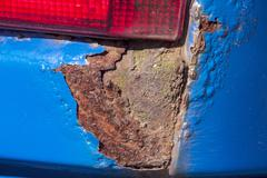Extreme Closeup of Severe Rust Corrosion on Vehicle - stock photo