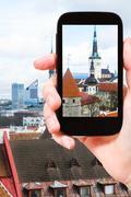 Tourist photographs cathedrals in Tallinn city Stock Photos