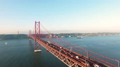 Cars on Bridge Ponte 25 de Abril over the river in Lisbon at morning aerial view Stock Footage