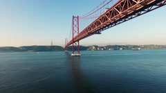 Bridge Ponte 25 de Abril over the Tagus river in Lisbon at morning aerial view Stock Footage