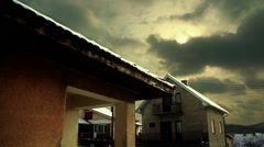 Clouds timelapse over houses Stock Footage