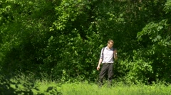 Man Talking on Phone in Park Tourist Resting Spend Time at the Nature Among Stock Footage
