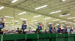 People paying food at check out counter inside superstore Stock Footage