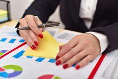 accountant woman tears off sticker - stock photo