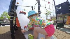 Toddler playground in urban area in the Summer. Stock Footage