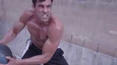 A strong man doing medicine ball exercises in slow motion Stock Footage
