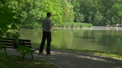 Businessman in Park Holding Virtual Tablet Forex Trading Payment Online Stock Footage